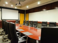 Projection Screen and Long Conference Table